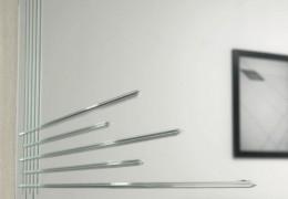 Specchio con incisione a disegno